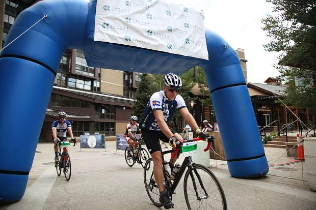 Cyclists ride into the checkpoint at Copper Mountain Resort as part of Saturday's Triple Bypass event, an annual 120-mile bike ride for more than 4,000 cyclists up and over several mountain passes east to west, from Evergreen to Avon. The event returned this year after wildfires cancelled the tour in 2017.