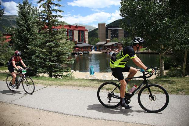 Cyclists ride through Copper Mountain Resort as part of Saturday's Triple Bypass event, an annual 120-mile bike ride for more than 4,000 cyclists up and over several mountain passes east to west, from Evergreen to Avon. The event returned this year after wildfires cancelled the tour in 2017.