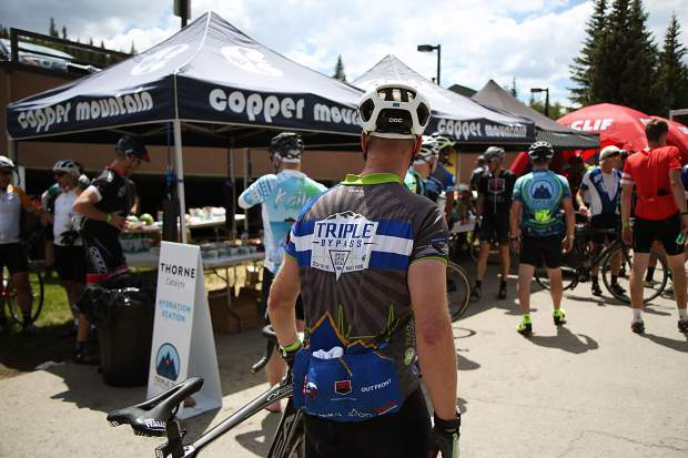 Bicyclists check out the pop-up tents at Copper Mountain Resort during Saturday's Triple Bypass event, an annual 120-mile bike ride for more than 4,000 cyclists up and over several mountain passes east to west, from Evergreen to Avon. The event returned this year after wildfires cancelled the tour in 2017.