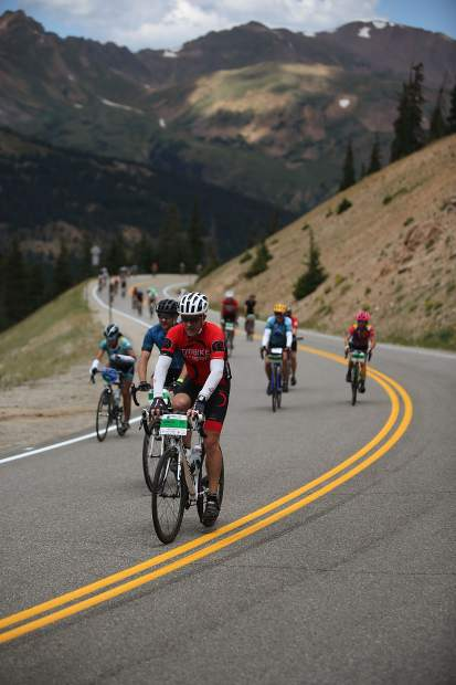 A line of cyclists ascend part of the Triple Bypass course during Saturday's Triple Bypass event, an annual 120-mile bike ride for more than 4,000 cyclists that takes them up and over several mountain passes east to west, from Evergreen to Avon. The event returned this year after wildfires cancelled the tour in 2017.