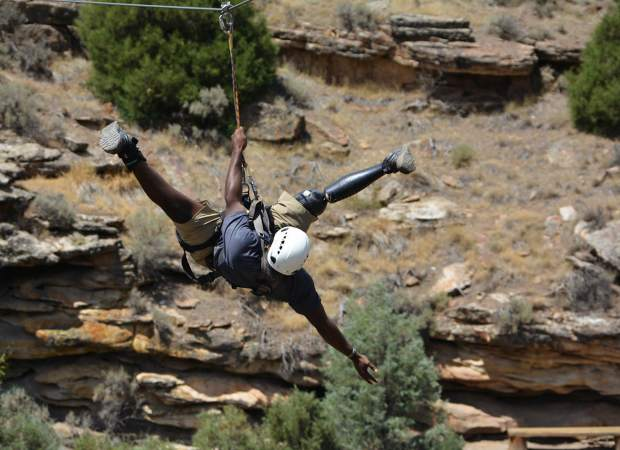 Donovan Hollis ziplines in Wolcott during this week's Vail Veterans Program.