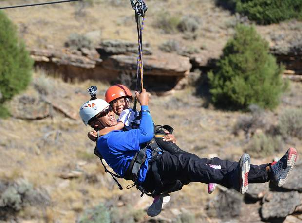 Aries Baluyot and daughter Kyla are all smiles during zip lining in Wolcott. The Baluyot family is in town with the Vail Veterans Program's summer family session.