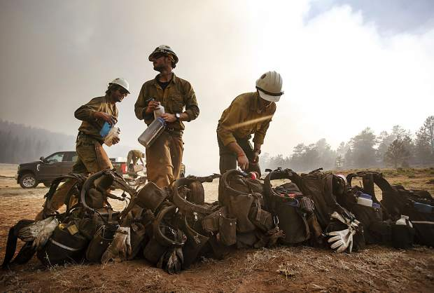 Members of the Craig Hotshots firefighters take a break from battling the Weston Pass Fire July 2, 2018, near Fairplay.