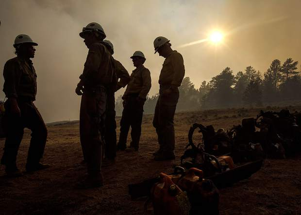 Members of the Craig Hotshots firefighters take a break from battling the Weston Pass Fire Monday, July 2, near Fairplay.