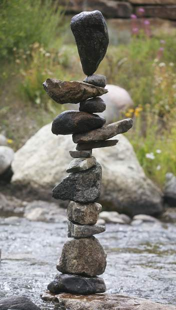 Stacked rocks created by artist Michael Grab sit in the Blue River in part of Breckenridge International Festival of the Arts Friday, Aug. 10, in Breckenridge.
