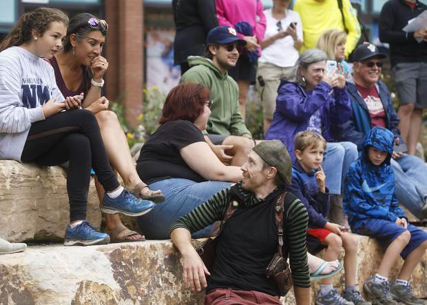 Artist Michael Grab interacts with passerbys who watched his work in progress on the Blue River in part of Breckenridge International Festival of the Arts Friday, Aug. 10, in Breckenridge.