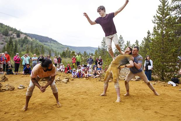 Gravity & Other Myths send Joshua Strachan in the air during the performance in front of crowds along the Wellington Trail Thursday, Aug. 16, in Breckenridge.