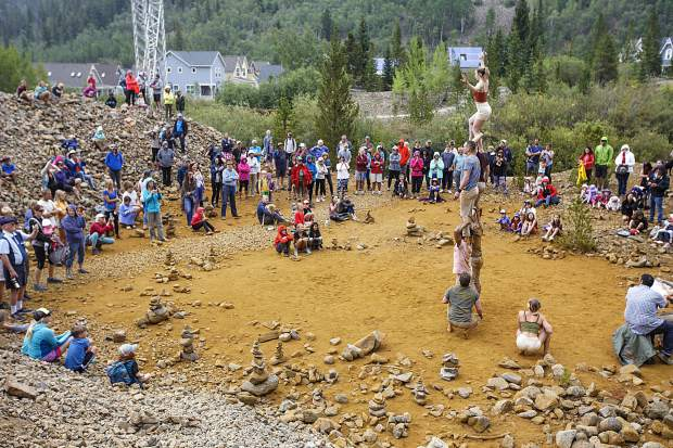 Hikers watch the Gravity & Other Myths perform along the Wellington Trail Thursday, Aug. 16, in Breckenridge.