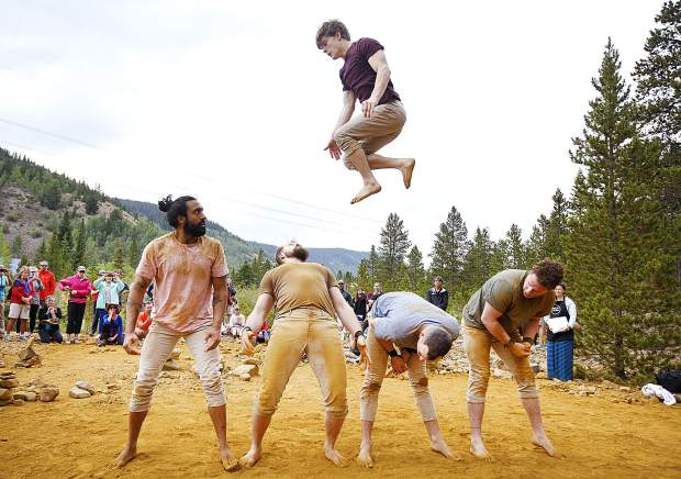 Acrobats of the Gravity & Other Myths perform in a free circus teaser in front of crowds along the Wellington Trail Thursday, Aug. 16, in Breckenridge.