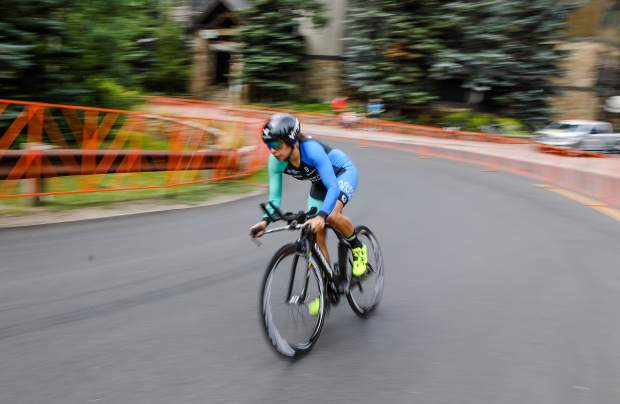 The women push up the time trial course for the Colorado Classic on Friday in Vail. The course went from Vail Village up Vail Pass.