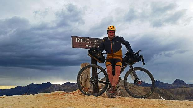 Justin Simoni, 37, of Boulder poses for a self-timed photo at Imogene Pass at 13,114-feet during his 60-plus day summer 2017 self-supported bike-and-hike journey of the105 highest mountains in Colorado. On Wednesday, he spoke about the odyssey to local Summit County folk at Wilderness Sports in Dillon.