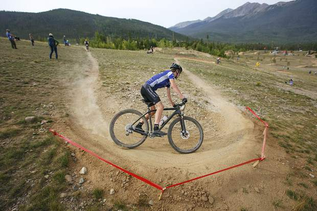 A high school mountain bike competitor brakes around the switchback in the Frisco Bay Invite Saturday, Aug. 25, near the Frisco Adventure Park.