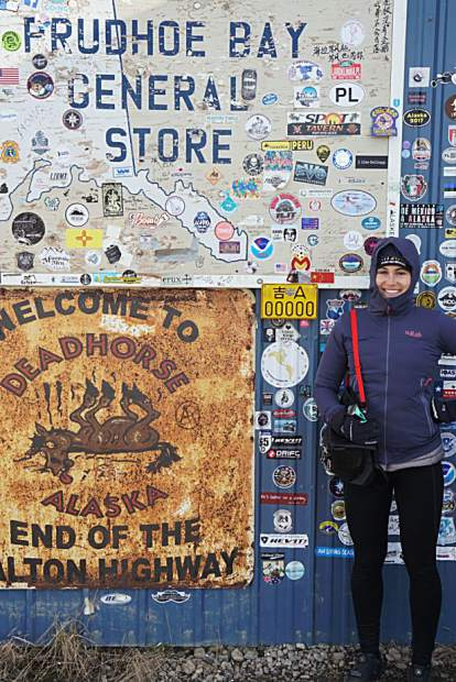Caitlin Hewitt poses for a photo in Prudhoe Bay, Alaska, the starting point on her and Devon Proctor's 19,000-mile, year-long bikepacking journey from Prudhoe Bay down to Ushuaia, Argentina. Along the way, their stopped in Frisco last week.