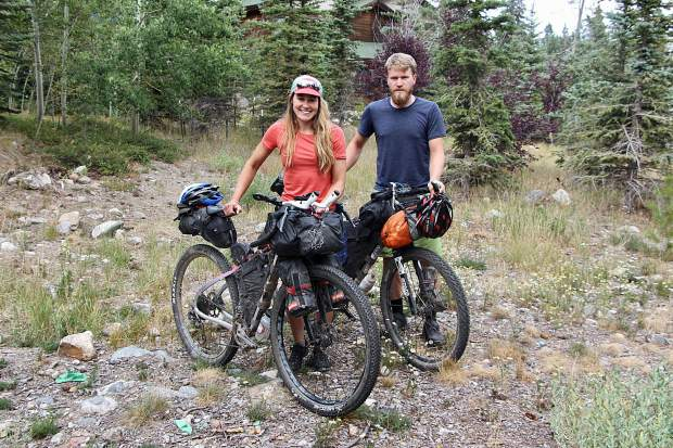 Caitlin Hewitt and Devon Proctor of San Francisco pose for a photo with their bicycles and bikepacking gear during their stop in Frisco last week along their 19,000-mile, year-long bikepacking journey from Prudhoe Bay, Alaska down to Ushuaia, Argentina.