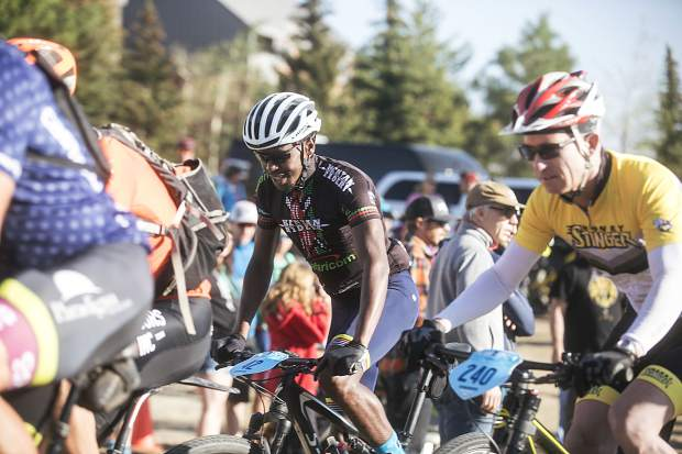 Patrick Willy, of Kenya, takes off with other Breck Epic participants on the fifth day of racing for the 10th annual multi-stage mountain biking event on Thursday at the start line near Beaver Run Resort and Conference Center in Breckenridge.