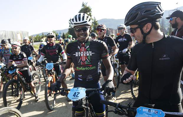 Patrick Willy, of Kenya, chats with a fellow Breck Epic participant ahead of the fifth day of racing for the 10th annual multi-stage mountain biking event on Thursday at the start line near Beaver Run Resort and Conference Center in Breckenridge.