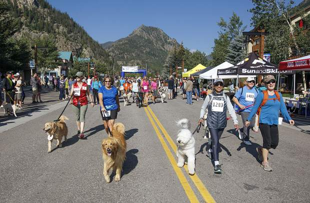 People and dogs take part of the LAPS K94K run and walk fundraiser Saturday, Aug. 4, on Frisco's Main Street.