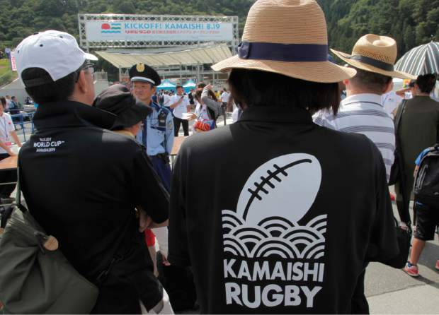 In this Aug. 19 photo, fans queue up to enter Kamaishi Recovery Memorial Stadium to watch a memorial rugby match between the Kamaishi Seawaves and Yamaha Jubilo in Kamaishi, northern Japan.