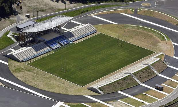 This July 27, 2018, aerial photo, shows Kamaishi Recovery Memorial Stadium in Kamaishi, northern Japan. Japan opened the new stadium Sunday, Aug. 19, 2018, for the 2019 Rugby World Cup on the site of a school that was destroyed by a devastating tsunami in 2011. The 6,000-seat stadium, the only new one built for the World Cup, stands on the former grounds of an elementary school and a junior high school. (Naohiko Hatta/Kyodo News via AP)