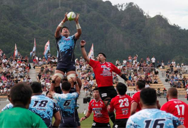 In this Aug. 19 photo, Yamaha Jubilo's Kuwano Eishin, top left, is lifted to receive a high ball during a memorial match against the Kamaishi Seawaves at Kamaishi Recovery Memorial Stadium in Kamaishi, northern Japan. Japan opened the new stadium for the 2019 Rugby World Cup on the site of a school that was destroyed by a devastating tsunami in 2011. The teams faced off in a memorial match in the small coastal city of Kamaishi to honor victims of the deadliest disaster in Japan's recent history.
