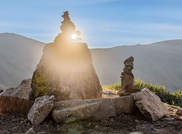 Sun peeks through a pile of rocks on Loveland Pass.