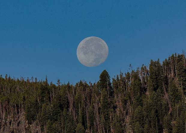 The moon setting behind Swan Mountain on Tuesday morning.