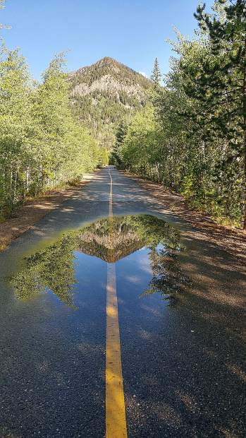 Rain puddle on the recreational pathway in Frisco on Monday.