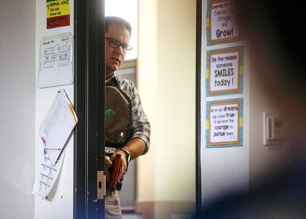 During a reality-based training, Summit County Sheriff detective Scott Wagner speaks with a school shooter before entering the classroom with laser tag gun at Silverthorne Elementary School Wednesday, Aug. 1, in Silverthorne.