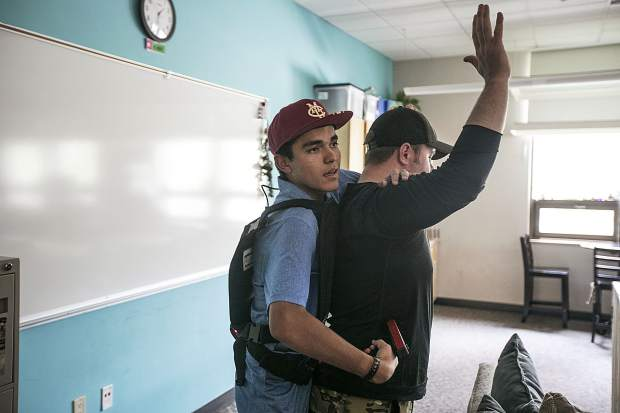 Impersonating as a shooter during training, Donovan Rubio, speaks with the Summit County Sheriff deputies while holding a hostage in a classroom with a laser tag handgun Wednesday, Aug. 1, at Silverthorne Elementary School.