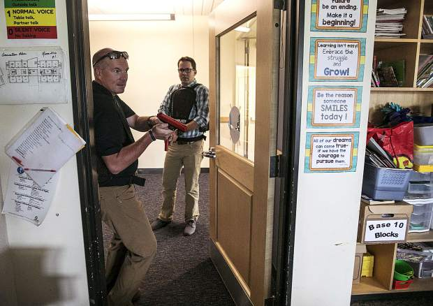 During a reality-based training, Summit County Sheriff lieutenant Thomas Whelan, left, and detective Scott Wagner enter the classroom with laser tag guns to contain a school shooter at Silverthorne Elementary School Wednesday, Aug. 1, in Silverthorne.