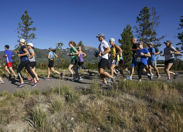 Run the Rockies half-marathon and 10-kilometer trail run participants take off for the race Saturday near Frisco Adventure Park.