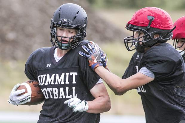 Summit High School football players practice at Tiger Stadium on Tuesday, Aug. 21, in Breckenridge.