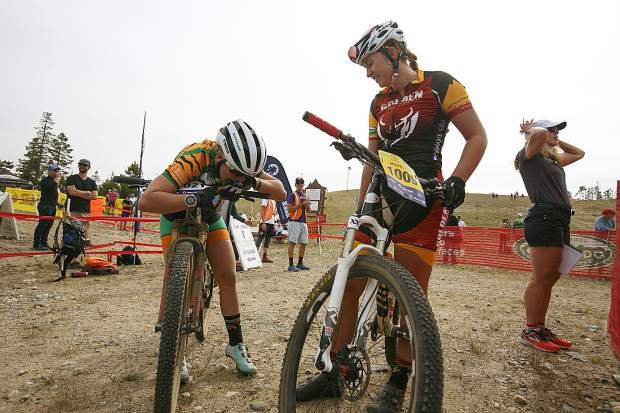 Summit High School varsity mountain biker Tai-Lee Smith, left, catches her breath at the finish line with Madelynn Gerritsen, of Golden, during the Frisco Bay Invite on Saturday near the Frisco Adventure Park.