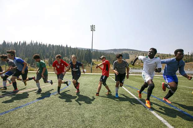 Summit High School soccer players sprint during a team workout on Monday, Aug. 20, at Climax Molybdenum Field at Tiger Stadium in Breckenridge.