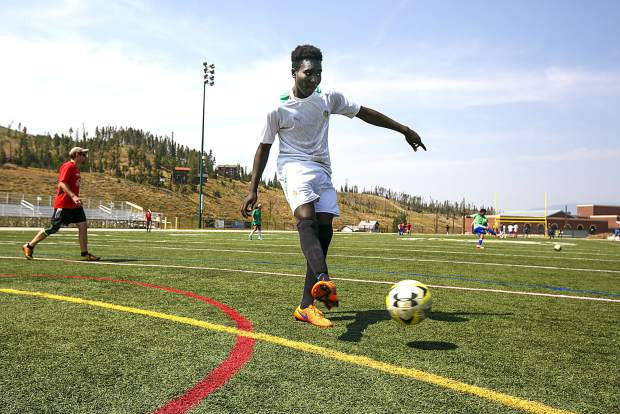 Summit High School senior and first-year player Hamidou Ndiaye, a native of Senegal, turns and passes to a teammatee during a drill during varsity soccer practice on Monday, Aug. 20, at Climax Molybdenum Field at Tiger Stadium in Breckenridge.