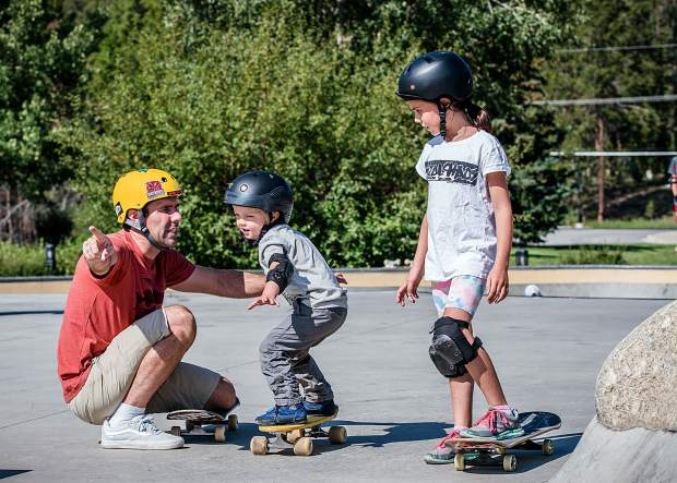 Pro Skater Andy MacDonald, winner of 23 X-Games medals, helps a yongster as part of the BIFA Concreate Jams: Skate+Jazz Youth Clinic
