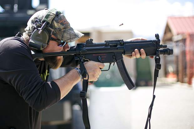 Dillon Police Department Sergeant Adam Nance fires the MP5 submachine gun during the Top Gun Competition among Summit County's law enforcement agencies Wednesday, Aug. 29, at the private shooting range in Dillon.