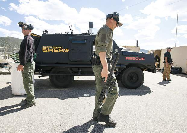 Breckenridge Police Department Officer Derek Bluhm walks with the machine gun following tactical course run during the Top Gun Competition among Summit County's law enforcement agencies Wednesday, Aug. 29, at a private shooting range in Dillon.