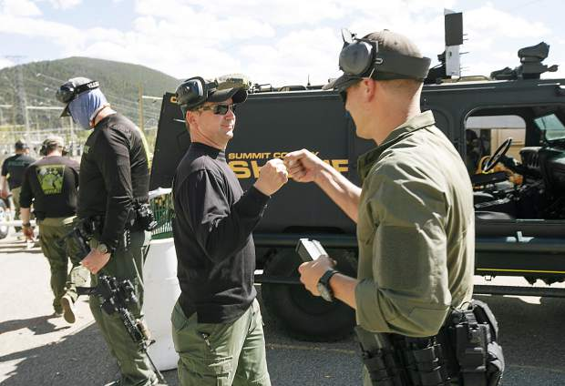 Commander SJ Hamit fist bumps Breckenridge Police Department Officer Derek Bluhm following the tactical course run during the Top Gun Competition among Summit County's law enforcement agencies Wednesday, Aug. 29, at a private shooting range in Dillon.
