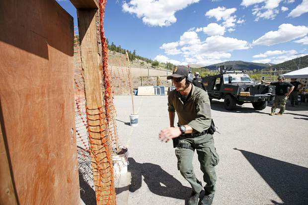 Breckenridge Police Department Officer Derek Bluhm runs to knock down a door on the tactical course run during the Top Gun Competition among Summit County's law enforcement agencies Wednesday, Aug. 29, at a private shooting range in Dillon.