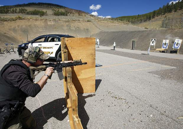 Dillon Police Department Sergeant Adam Nance fires the rifle on the tactical course run during the Top Gun Competition among Summit County's law enforcement agencies Wednesday, Aug. 29, at a private shooting range in Dillon.