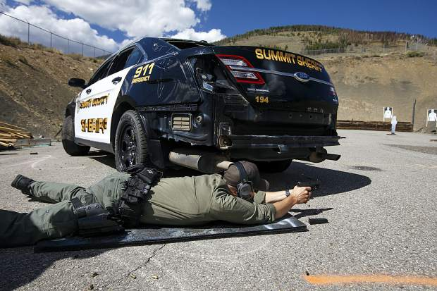 Breckenridge Police Department Officer Derek Bluhm fires the rifle on the tactical course run during the Top Gun Competition among Summit County's law enforcement agencies Wednesday, Aug. 29, at a private shooting range in Dillon.
