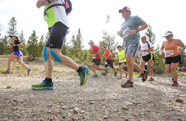 Runners take off at the Gold Run trailhead for the fifth of six Summit Trail Running Series trail running events this summer, the Gold Run Trailhead 7K/11K, last Wednesday in Breckenridge.