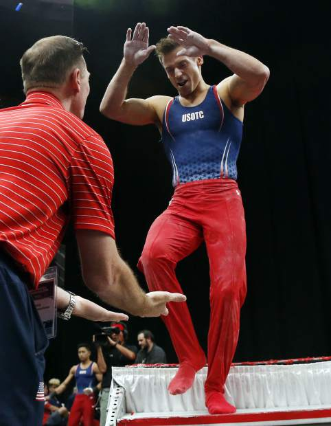 Sam Mikulak, right, celebrates after competing on the pommel horse at the U.S. Gymnastics Championships, on Saturday in Boston.