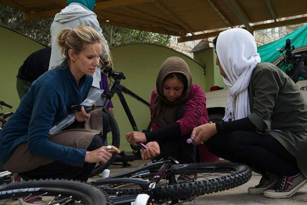 Summit County local Shannon Galpin helps young Afghan women work on their bicycles.