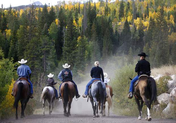 Cowboys and local law enforcement wrap up the cattle drive between the two ranches on Highway 9 Tuesday, Sept. 11, north of Silverthorne.