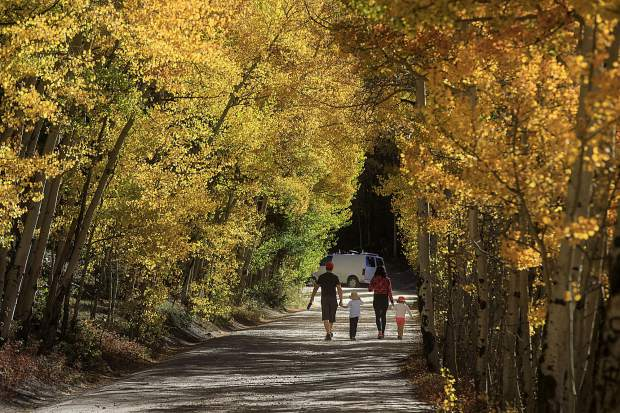 A family takes a stroll on Boreas Pass Road Saturday, Sept. 15, in Breckenridge.