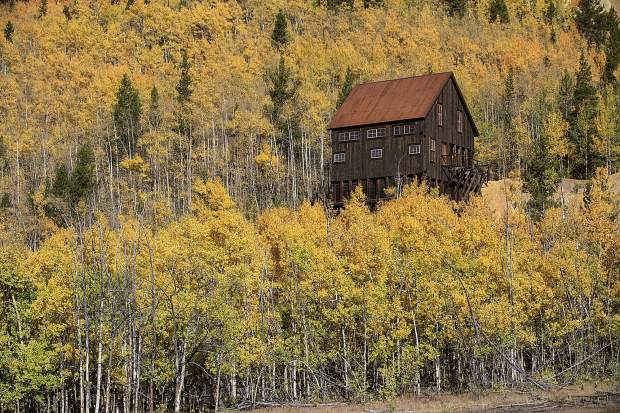 A structure part of the Extunuate Mine is surrounded by changing aspens Saturday, Sept. 15, in Breckenridge.