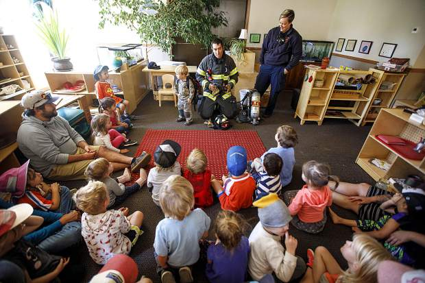 Red, White, and Blue Firefighter Paramedics Chris Drumwright, left, and Lacey Theiler lead an educational fire safety session in class Thursday, Sept. 27, at Little Red SchoolHouse in Breckenridge.