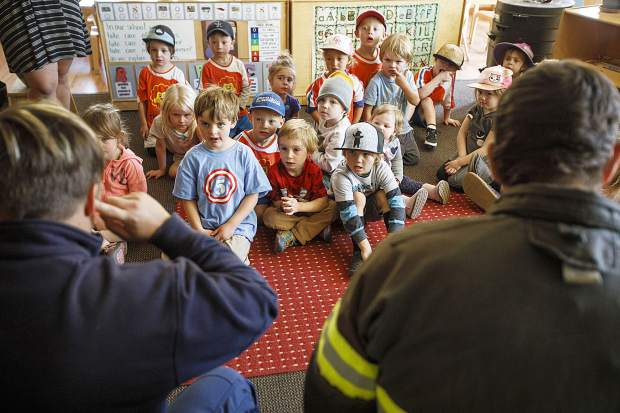 Little Red SchoolHouse students listen as Red, White, and Blue Firefighter Paramedics Chris Drumwright, at right, and Lacey Theiler lead an educational fire safety session in class Thursday, Sept. 27, in Breckenridge.